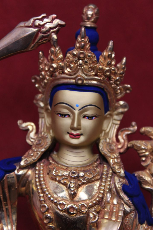 full gold Buddha Manjushri Statue face