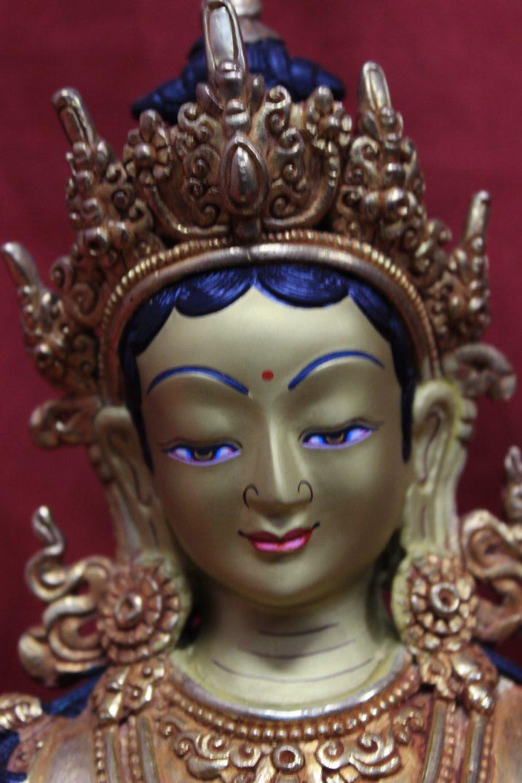 green tara goddess face
