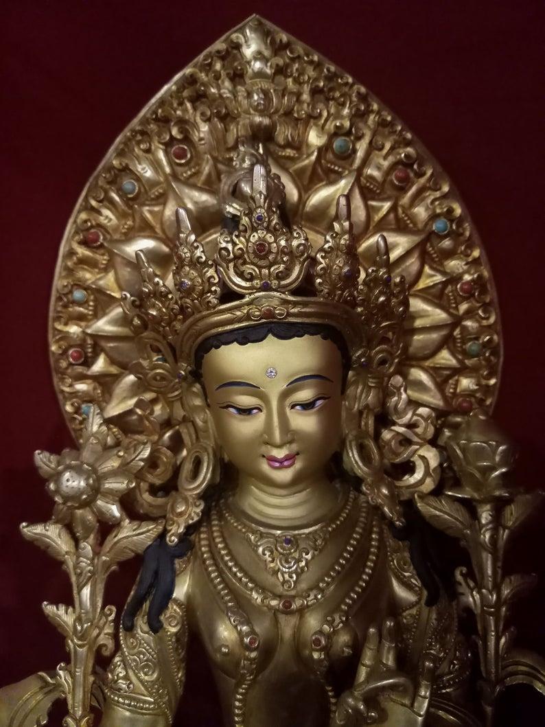 golden green tara statue