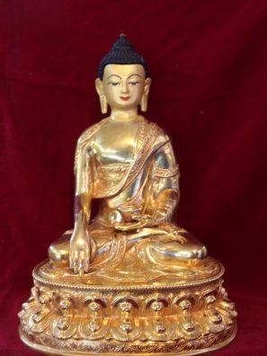 shakyamuni buddha gold figurine