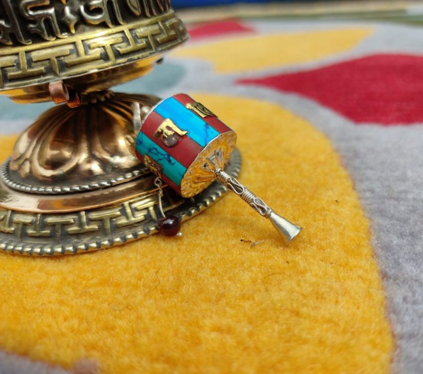 Newari Prayer Wheel Pendant present