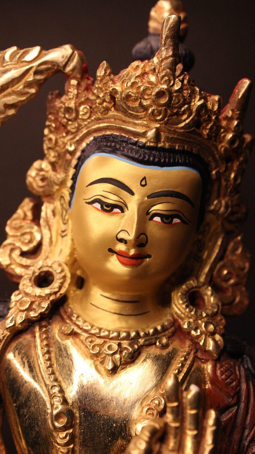golden manjushree figurine